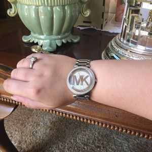 Michael Kors silver watch with round MK pave face
